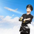 Image of male pilot with airplane at background — Stock Photo #19581355