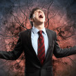 Businessman in anger with fists clenched screaming - Stock fotografie
