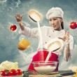 Stock Photo: Asifemale cooking with magic against color background