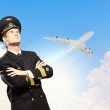 Image of male pilot with airplane at background — Stock Photo #19581693
