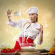 Asian female cooking with magic against color background — Stock Photo #19581733