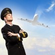 Male pilot with airplane at background — Stock Photo #19581971