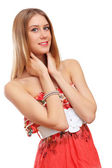 Beautiful young blond woman in red dress — Stock Photo