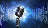 Single retro microphone against colourful background with lights — Zdjęcie stockowe