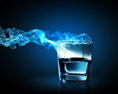 Image of glass of blue cocktail with fume going out — Stock Photo