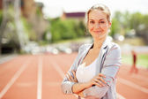 Businesswoman sport manager and executive at athletic stadium and race track — Stock Photo