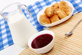 Continental breakfast with croisant and milk — Stock Photo