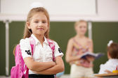 Little blonde girl studying at school class — Stock Photo