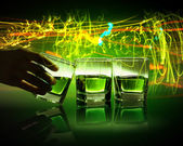 Hand holding one of three glasses of green absinth with fume going out — Stock Photo