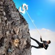 Busiessman climbing mountain — Stock Photo