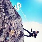 Busiessman climbing mountain — Stock Photo #21072787