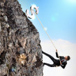 Stock Photo: Busiessman climbing mountain