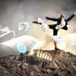 Businesswoman standing atop of mountain — Stock Photo