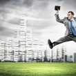 Image of running businessman - Stock Photo