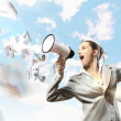 Businesswoman with megaphone - Stock Photo