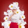 Asian female cook against milk splashes — Stockfoto