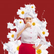 Asian female cook against milk splashes — Stock Photo #21079405