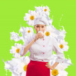 Asian female cook against milk splashes — Stock Photo #21079459