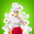Asian female cook against milk splashes — Stock Photo #21079915