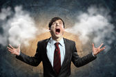 Uomo d'affari in rabbia — Foto Stock