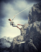 Businesswoman climbing mountain — Photo