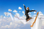 Businesswoman in black suit jumping — Stock Photo