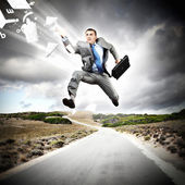 Businessman running on the road — Stock Photo