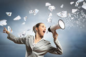 Businesswoman with megaphone — Stock Photo
