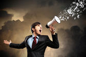 Businessman with megaphone — Stock Photo