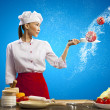 Photo: Asian female cook with knife