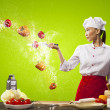 Asian female cook with knife — Stockfoto