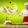 Asian female cook with knife - Stock Photo