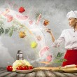 Asian female cook with knife — Stock fotografie
