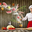 Asian female cook with knife — Stock Photo #21085501