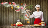 Asian female cook with knife — Stock Photo