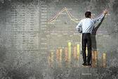 Businessman drawing diagram — Stock Photo