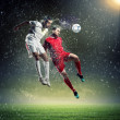 Two football players striking the ball — Stock Photo #21113815