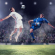 Two football players striking the ball — Stock Photo #21114041