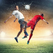 Two football players striking the ball — Stock Photo #21114099
