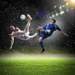 Two football players striking the ball — Stock Photo #21114543