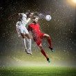 Two football players striking the ball — Stock Photo #21114935