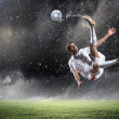 Stock Photo: Football player striking the ball