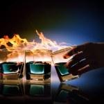 Three glasses of burning emerald absinthe — Stock Photo #21115201