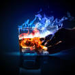 Two glasses of burning absinthe - Stock Photo