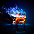 Stock Photo: Two glasses of burning absinthe