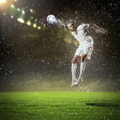 Football player striking the ball — Foto Stock