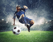 Football player striking the ball — Stock Photo