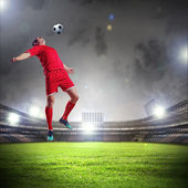 Football player striking the ball — Photo