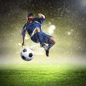 Football player striking the ball — Stock Photo