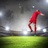 Football player striking the ball — Stockfoto